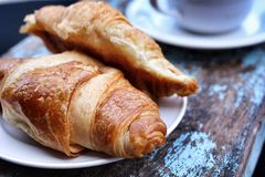 Croissant and a cup coffee Royalty Free Stock Image