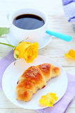 Croissant and a cup of coffee Stock Photos