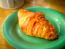 A croissant and a cup of coffee Royalty Free Stock Photography