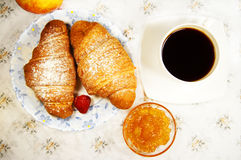 Croissant and cup of coffee Stock Photo