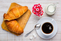 Croissant and Cup of Coffee Stock Photos