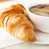 Croissant and a cup of delicious coffee Royalty Free Stock Photo