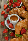 Croissant and a cup of espresso Royalty Free Stock Photos