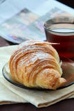 Croissant and a cup of tea. French breakfast stock image