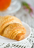 Croissant with cup of tea Stock Photo