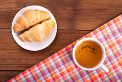 Croissant and cup of tea Stock Image