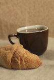 Croissant and a cup of tea Royalty Free Stock Photo