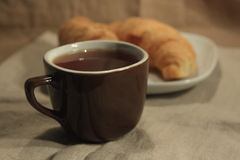 Croissant and a cup of tea Stock Photo