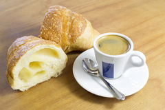 Croissant Cut in Half and Cup of Coffee For Breakfast on Wooden Table Stock Photography