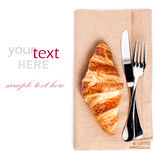 Croissant and cuttery on linen napkin isolated on white backgrou Stock Image