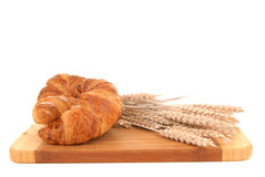 Croissant on cutting board Stock Image