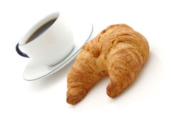Croissant, cuvette de café Images stock