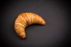 Croissant on dark plate Stock Image