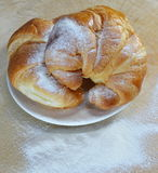 Croissant on the dish Stock Images