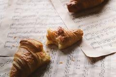 Croissant dois em papéis velhos Imagem de Stock Royalty Free