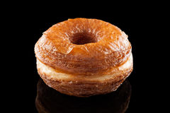 Croissant and doughnut mixture isolated on black Royalty Free Stock Photography