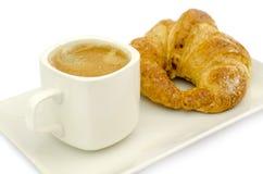 Croissant e una tazza di caffè delicous Fotografie Stock