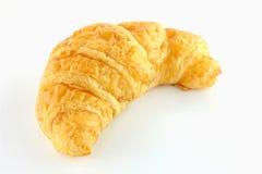 Croissant en el fondo blanco Foto de archivo