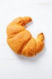 Croissant en el fondo blanco foto de archivo libre de regalías