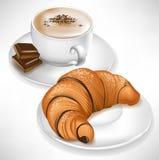 Croissant en la taza de la placa y de café Fotos de archivo