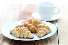 Croissant et café Photos stock