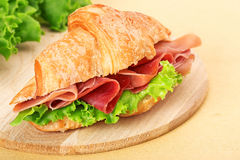 Croissant filled with ham and lettuce Royalty Free Stock Images