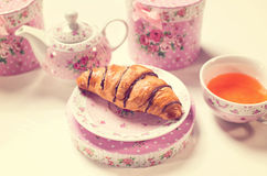 Croissant on floral decor Royalty Free Stock Image