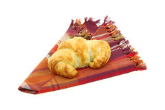 Croissant on Folded Plaid Napkin Royalty Free Stock Images