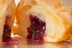 Croissant French brioche filled with berries jam Royalty Free Stock Image