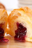 Croissant French brioche filled with berries jam Royalty Free Stock Photo