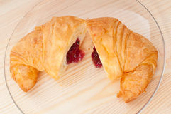 Croissant French brioche filled with berries jam Stock Photography