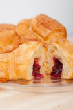 Croissant French brioche filled with berries jam Stock Photo