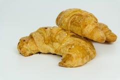 Croissant freschi isolati su fondo bianco Fotografia Stock