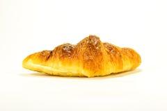 Croissant fresco en el fondo blanco Fotografía de archivo