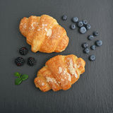 Croissant  with fresh berries Royalty Free Stock Photography
