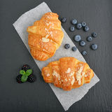 Croissant  with fresh berries Stock Photos