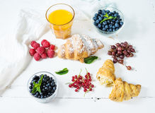Croissant with fresh berry and juice for breakfast Stock Photos