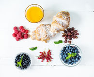 Croissant with fresh berry and juice for breakfast. Stock Photography