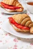 Croissant with fresh strawberries, ricotta Stock Photo