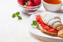 Croissant with fresh strawberries, ricotta Royalty Free Stock Photo