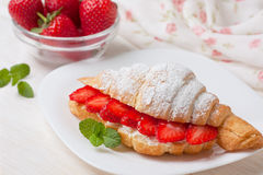 Croissant with fresh strawberries, ricotta Stock Photos