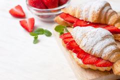 Croissant with fresh strawberries, ricotta Stock Images