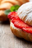 Croissant with fresh strawberries Stock Photo