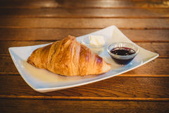 Croissant and fruit cream jam. On a wooden table Stock Photo