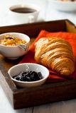 Croissant and fruit jam on a rustic tray Royalty Free Stock Photography