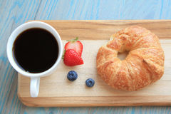 Croissant fruit and mug of coffee Royalty Free Stock Photo
