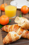 Croissant and fruits Stock Image