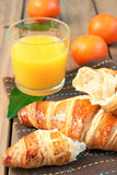 Croissant and fruits Stock Images