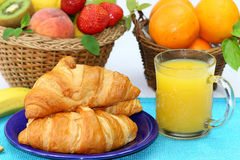 Croissant, fruits, and orange juice. Breakfast with fruits, cereals and drinks Royalty Free Stock Image