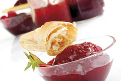 Croissant on glass bowl with raspberry jam Stock Photography